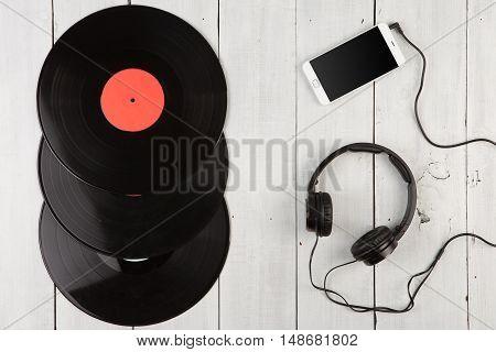 Vintage Lp, Smartphone And Headphones