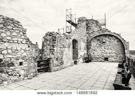 Ruin castle of Visegrad Hungary. Ancient architecture. Travel destination. Cultural heritage. Beautiful place. Black and white photo.