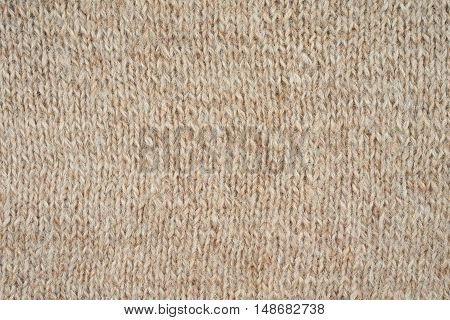 Beige knitted pattern as a seamless background