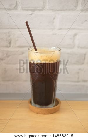 Delicious ice coffee americano on wood table