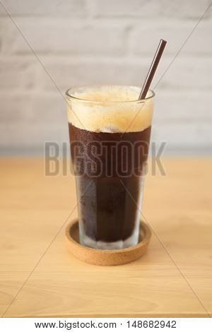 iced americano on wood table in cafe shop