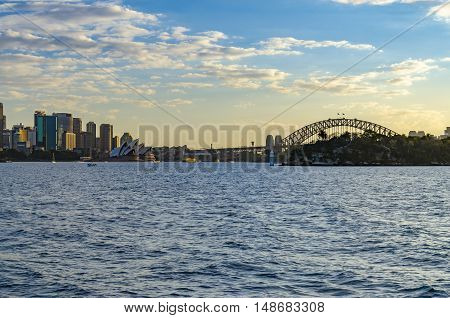 Two landmarks of sydney: The opera  and the harbour bridge.