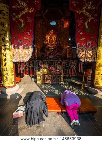 Suzhou China - October 232016: Believers praying in the Buddhist Bao'en Temple (Beisi Temple or North Temple Pagoda) in Suzhou Jiangsu Province China.