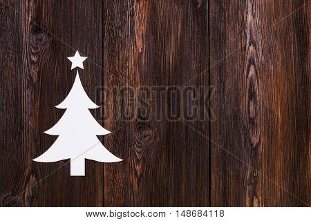 Paper christmas tree with copy space. Wooden background. Abstract conceptual image