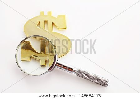 magnifier glass with dollar sign on the white background