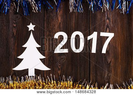 Paper christmas tree with 2017. Wooden background. Abstract conceptual image