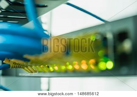 Blurred network optical fiber cables in swhite