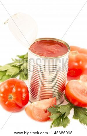 Tomato sauce in the can with the fresh tomatoes and celery leaves