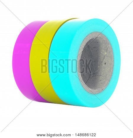 Magenta yellow cyan insulating tape reels isolated on white background.