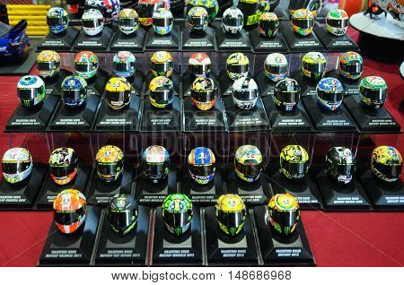 SERDANG, MALAYSIA -JULY 30, 2016: Miniature model of MotoGP champion Valentino Rossi helmets arranged on the table.
