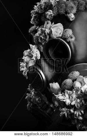 Portrait Of Woman With Flowers Growing Through Respirator Mask. Black And White