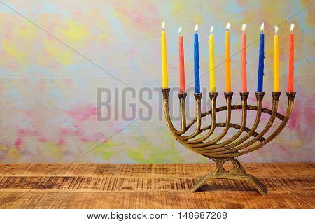 Menorah with color candles for Hanukkah celebration