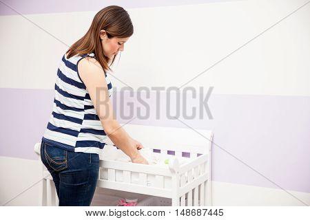 Pregnant Woman Organizing The Nursery