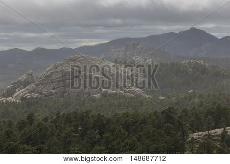 A scenic view of the Black Hills on a stormy day.