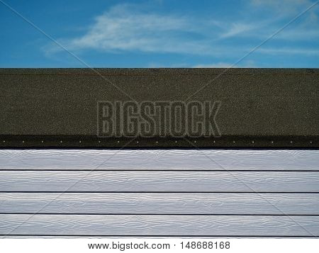 beach hut with roof and blue sky