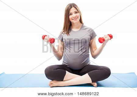 Pretty Pregnant Woman Working Out