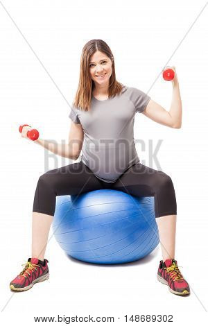 Strong Pregnant Woman Exercising