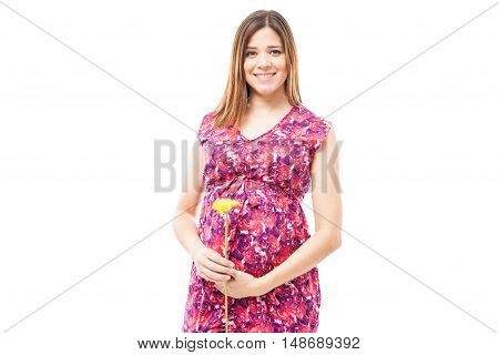 Beautiful Pregnant Woman With A Flower