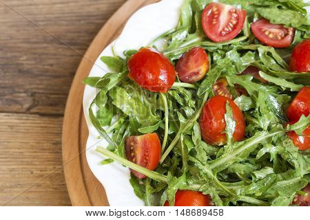 Rocket and cherry tomato salad close up