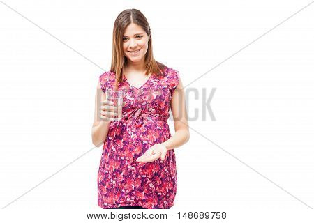 Pregnant Woman Taking Some Vitamins