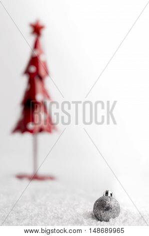 Christmas Tree And Gray Ball With Snowflakes On White Background