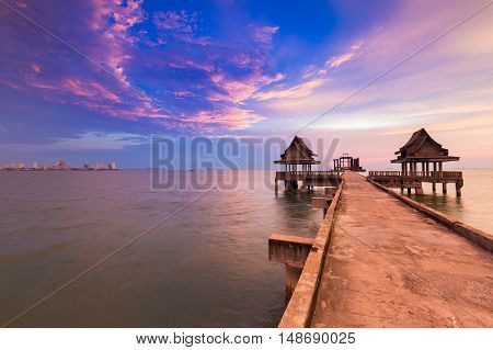 Natural landscape walking way leading to sea, skyline with dramatic sunset sky background
