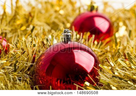 Christmas Background With A Red Balls And Yellow Garland.