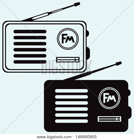 Old radio receiver. Isolated on blue background. Vector silhouettes