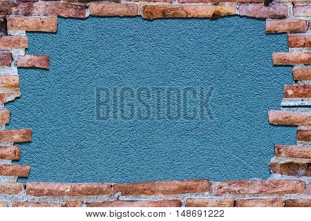 Ancient Red Brick Wall Over Background Blue.