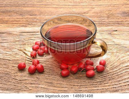 Hawthorn tea and ripe fruits of hawthorn