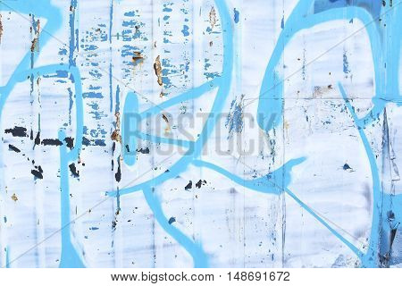 Blue grunge painted tin surface as background