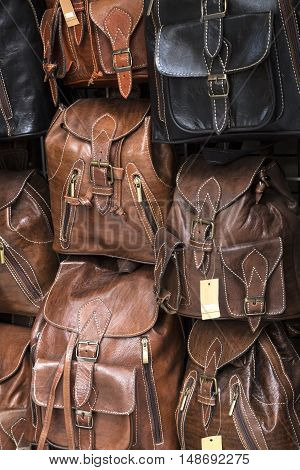 Leather back packs on a street market