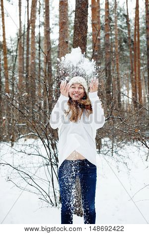 Young Beautiful Woman Having Fun In Winter Park