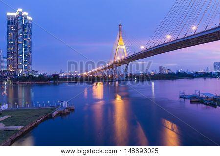 Suspension bridge cross Bangkok river with twilight sky background