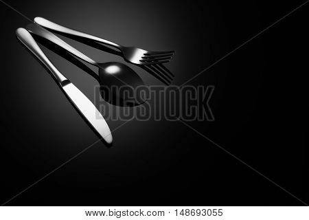 Stainless steel, modern silverware on black background with reflection. Image with copy space. Symbol or concept for diners, cafes and good food competitions and festivals