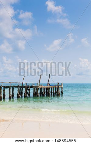 Natural beach and fishing walkway with natural blue sky background