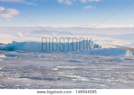 Ice breaking in Jakulsalon lagoon, natural winter landscape background, Iceland