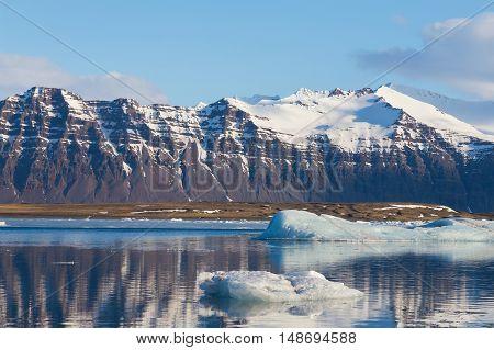 Iceland Jokulsarlon lagoon with mountain background, natural winter season landscape background