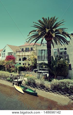 Venice Canals Walkway with river and boat in Los Angeles, California.