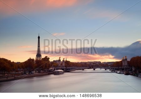 Paris River Seine with Eiffel tower and Alexandre III bridge at sunset
