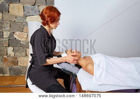 Head neck and facial massage woman with physiotherapist indoor
