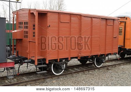 Old wagon in the train intended for the carriage of cargo.