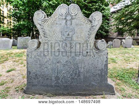 Boston, Massachusetts - September 5, 2016: Detail of an old headstone in the King's Chapel Burial Ground in Boston Massachusetts.