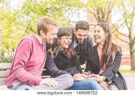 Group Of Friends Having Fun At Park In Berlin