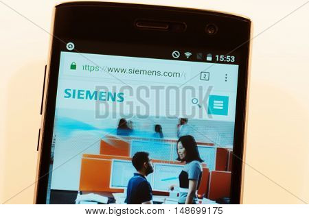 SARANSK, RUSSIA - SEPTEMBER 24, 2016: A smartphone screen shows details of Siemens AG main page on its web site.