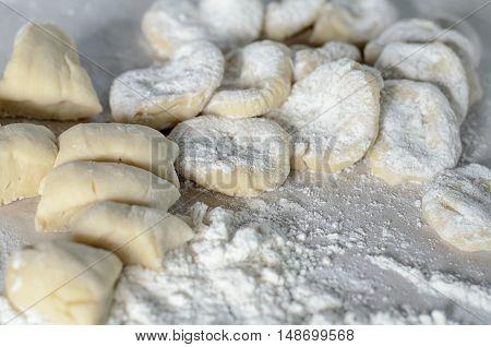 The cut dough to floured rolling. Making of pierogi with Cherry.