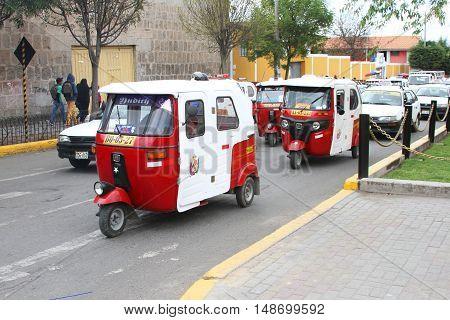 Cajamarca Peru - September 23 2016: Moto-taxi traffic on busy street in Cajamarca Peru on September 23 2016