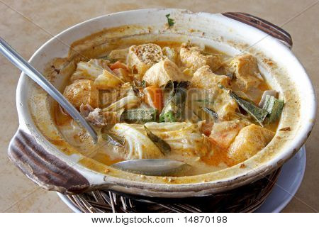 Fish head curry in clay pot traditional malaysian cuisine