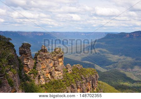 The Three Sisters is a rock formation in the Blue Mountains of New South Wales, Australia, on the north escarpment of the Jamison Valley. They are close to the town of Katoomba and are one of the Blue Mountains' best known sites, towering above the Jamiso