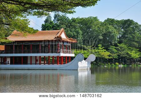 Jurong, Singapore - April 14, 2011: Pavillion beside water in Chinese Garden/Jurong Garden, one of biggest park in Singapore